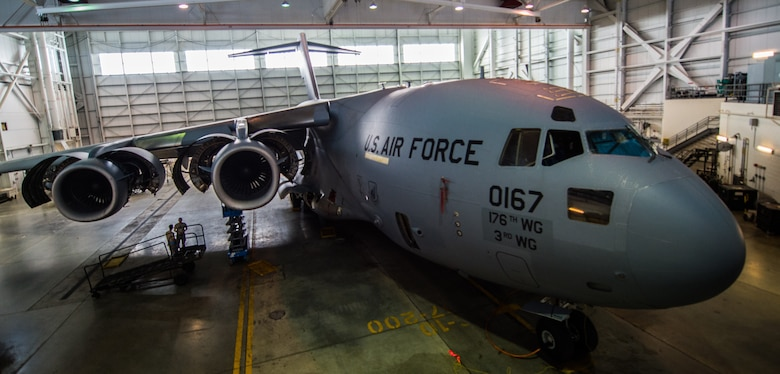 A C-17 Globemaster III assigned to the 176th Wing sits inside a hangar for a home station check at Joint Base Elmendorf-Richardson, Alaska, March 27, 2018. The 3rd and 176th maintenance squadrons complete an in-depth, four-day scheduled inspection of a C-17 approximately every 180 days. A home station check is the behind-the-scenes maintenance that can prevent loss of life, lead to savings in time and money and keep the aircraft fit to fight.