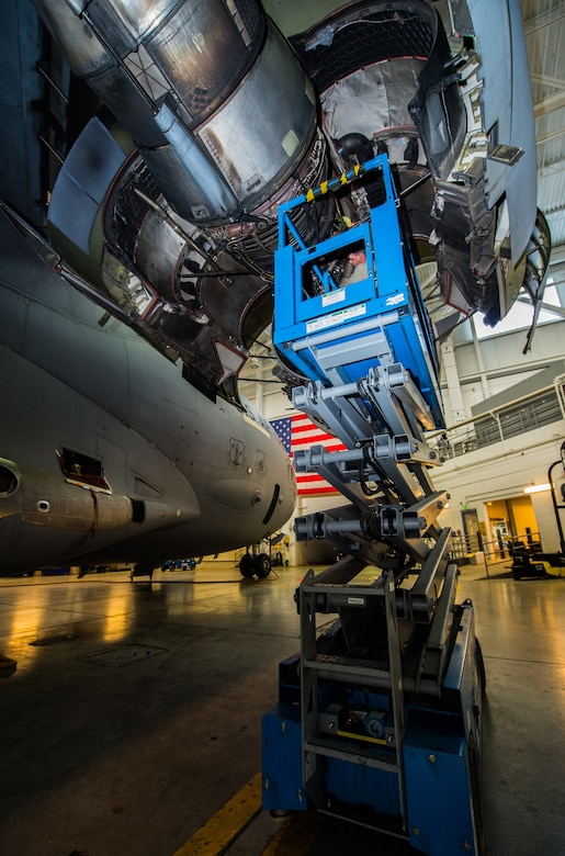 Senior Airman Austin Barbahm, 3rd Maintenance Squadron aerospace propulsion journeyman, and Airman 1st Class Adam Babcock, 3rd MXS aerospace propulsion apprentice, perform maintenance on a C-17 Globemaster III assigned to the 176th Wing during a home station check at Joint Base Elmendorf-Richardson, Alaska, March 27, 2018. The 3rd and 176th maintenance squadrons complete an in-depth, four-day scheduled inspection of a C-17 approximately every 180 days. A home station check is the behind-the-scenes maintenance that can prevent loss of life, lead to savings in time and money and keep the aircraft fit to fight.
