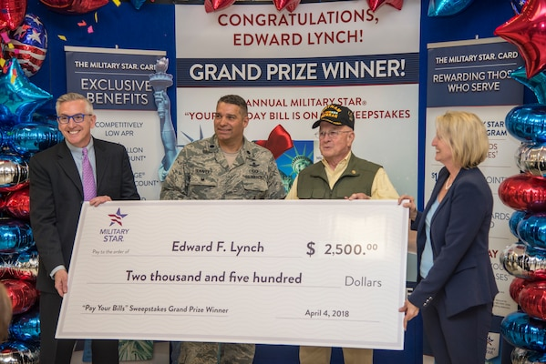 Retired Army Col. Edward Lynch (second from right) poses with (from left) James Jordan, Exchange chief financial officer; Lt. Col. Cas Benavidez, 502nd Force Support Group vice commander; and Jami Richardson, Exchange credit program senior vice president, after receiving a $2,500 check to pay off his Military Star card balance at the Joint Base San Antonio-Fort Sam Houston Exchange April 4. Lynch was entered into the contest when he used his card last fall to make a purchase.
