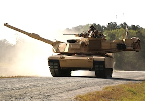 An M1A1-SA Abrams tank belonging to D Troop, 6th Squadron, 8th Cavalry Regiment, 2nd Armored Brigade Combat Team, 3rd Infantry Division, moves along the boundary road en route to its battle position during the gunnery qualification at Fort Stewart, Ga.