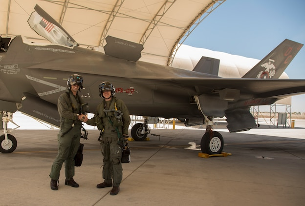 The Commanding Officer of Marine Fighter Attack Squadron 122 (VMFA-122), Lt. Col. John P. Price, and Maintenance Officer of VMFA-122, Maj. Christopher J. Kelly pose for a photo after conducting VMFA-122's first flight operations in an F-35B Lightning ll at Marine Corps Air Station (MCAS) Yuma, Ariz., March 29, 2018. VMFA-122 conducted the flight operations for the first time as an F-35 squadron. (U.S. Marine Corps photo by Lance Cpl. Sabrina Candiaflores)