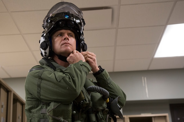 The Commanding Officer of Marine Fighter Attack Squadron 122 (VMFA-122), Lt. Col. John P. Price, straps his helmet on in preperation of VMFA-122's first flight operations in an F-35B Lightning II on Marine Corps Air Station (MCAS) Yuma, Ariz., March 29, 2018. VMFA-122 is conducting the flight operations for the first time as an F-35 squadron. (U.S. Marine Corps photo by Sgt. Allison Lotz)