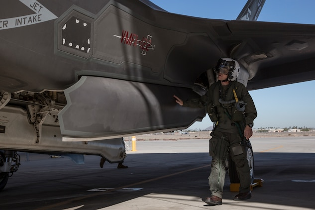 The Commanding Officer of Marine Fighter Attack Squadron 122 (VMFA-122), Lt. Col. John P. Price, conducts a pre-flight check of his aircraft in preperation of VMFA-122's first flight operations in an F-35B Lightning II on Marine Corps Air Station (MCAS) Yuma, Ariz., March 29, 2018. VMFA-122 is conducting the flight operations for the first time as an F-35 squadron. (U.S. Marine Corps photo by Sgt. Allison Lotz)