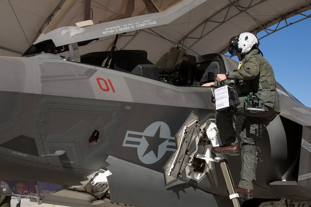 The Commanding Officer of Marine Fighter Attack Squadron 122 (VMFA-122), Lt. Col. John P. Price, enters his aircraft in preperation of VMFA-122's first flight operations in an F-35B Lightning II on Marine Corps Air Station (MCAS) Yuma, Ariz., March 29, 2018. VMFA-122 is conducting the flight operations for the first time as an F-35 squadron. (U.S. Marine Corps photo by Sgt. Allison Lotz)