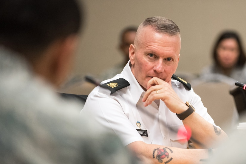 Army Command Sgt. Maj. John W. Troxell, senior enlisted advisor to the Chairman of the Joint Chiefs of Staff, sits in front of a microphone.