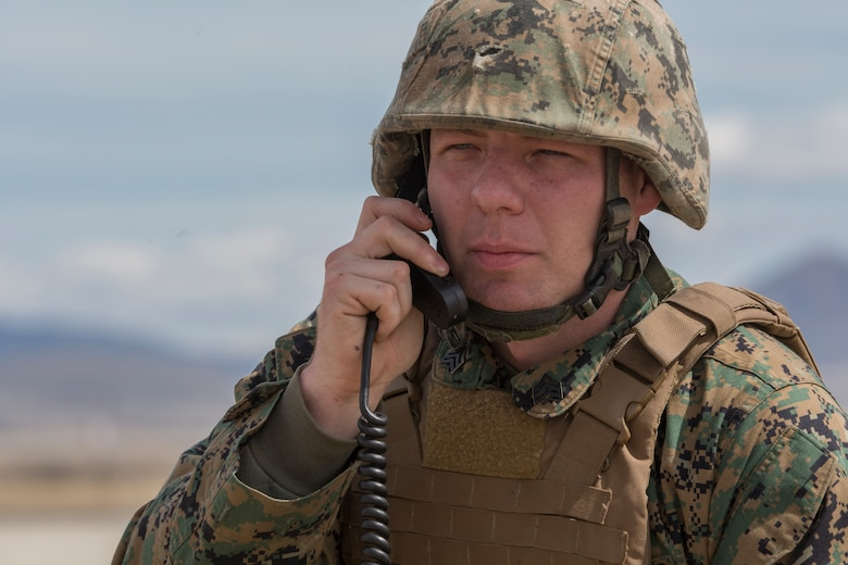 Marine Corps Sgt. Joshua Herod, communications chief with Kilo Battery, 2nd Battalion, 14th Marine Regiment, radios target coordinates to an M142 High Mobility Artillery Rocket System (HIMARS) at Dugway Proving Grounds, Utah, March 30, 2018. Marines from Kilo Battery flew from Fort Campbell, Ky., to Dugway where they offloaded and fired four HIMARS missiles, demonstrating a unique capability that will give commanders more options to deal with threats when other options are not appropriate.