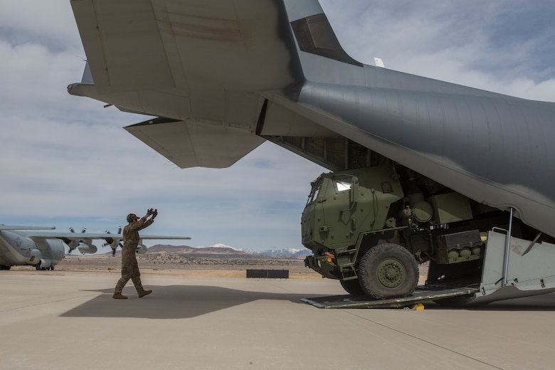 Air Force Staff Sgt. Josh Monroe, a loadmaster from 9th Special Operations Squadron, loads a Marine Corps M142 High Mobility Artillery Rocket System (HIMARS) from Kilo Battery, 2nd Battalion, 14th Marine Regiment, into an Air Force MC-130 at Dugway Proving Grounds, Utah, March 30, 2018. Marines from Kilo Battery flew from Fort Campbell, Ky., to Dugway where they offloaded and fired four HIMARS missiles, demonstrating a unique capability that will give commanders more options to deal with threats when other options are not appropriate.