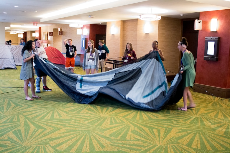 Teens of Reserve Citizen Airmen work together to pitch tents during a teamwork exercise at the Yellow Ribbon Reintegration Program event held March 16, 2018 in Orlando, Florida.