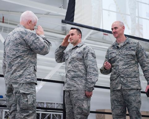 U.S. Air Force Tech. Sgt. Mark Pierson, 133rd Maintenance Group, is recognized and coined for volunteering to go on a short notice deployment in St. Paul, Minn., March 25, 2018.