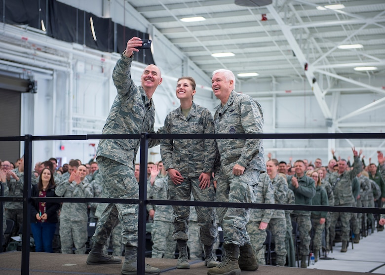 U.S. Air Force Senior Airman Paige Shepherd, 133rd Medical Group, takes a photo with Lt. Gen. L. Scott Rice, right, director, Air National Guard, and Chief Master Sgt. Ronald Anderson, left, Command Chief of the Air National Guard in St. Paul, Minn., March 25, 2018.