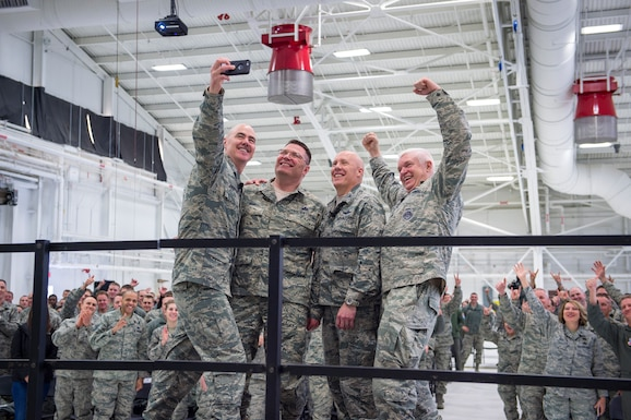 U.S. Air Force Col. Daniel Gabrielli, commander of the 133rd Airlift Wing, center right, and Chief Master Sgt. Lance Burg, Command Chief of the 133rd Airlift Wing, center left, pose for a selfie with Lt. Gen. L. Scott Rice, director, Air National Guard, and Chief Master Sgt. Ronald Anderson, right, Command Chief of the Air National Guard in St. St. Paul, Minn., March 25, 2018.