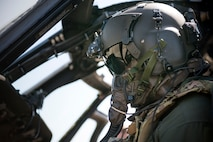 An HH-60G Pave Hawk pilot from the 41st Rescue Squadron performs post-flight operations during a chemical, biological, radiological and nuclear exercise, March 28, 2017, at Moody Air Force Base, Ga. The Airmen were geared up in mission-oriented protective posture (MOPP) gear to simulate potential conditions they could face while deployed in austere environments. While in MOPP gear, Airmen have to deal with claustrophobic conditions, impaired communication and battle the constant threat of heat exhaustion, while completing the mission. (U.S. Air Force photo by Airman 1st Class Erick Requadt)