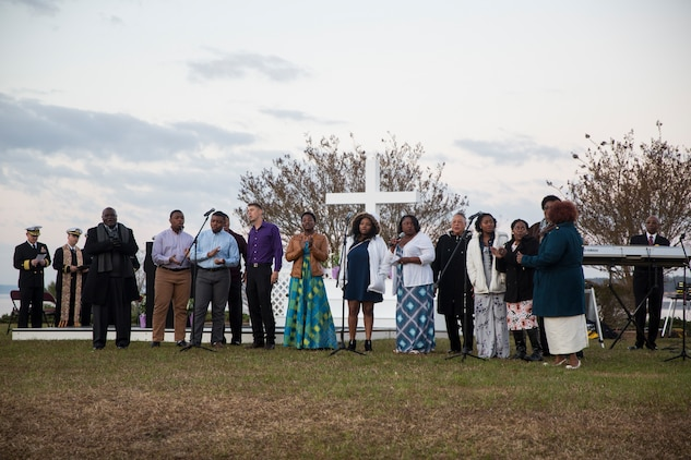 Members of the Tarawa Terrance Chapel priest team sing during the Easter Sunrise Service on Marine Corps Base Camp Lejeune, April 1. The service was held in the morning as the sun rises to symbolize the rise of Christ.