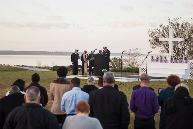 Navy Capt. J P. Hedges leads the Easter Sunrise Service with a message about the importance of the Easter service on Marine Corps Base Camp Lejeune, April 1. The service was held in the morning as the sun rises to symbolize the rise of Christ.