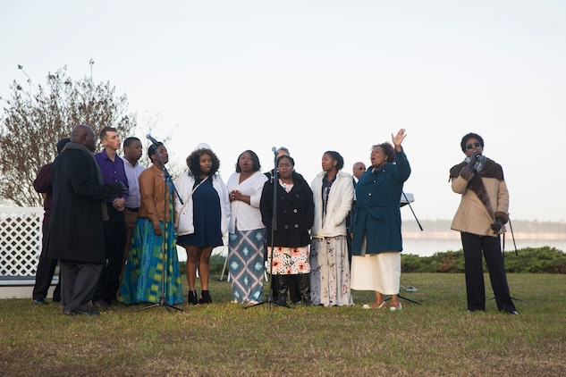 Members of the Tarawa Terrance Chapel priest team sings at the end of the Easter Sunrise Service on Marine Corps Base Camp Lejeune, April 1. The service was held in the morning as the sun rises to symbolize the rise of Christ.