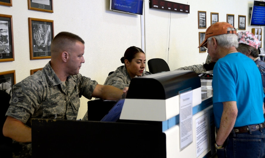 Senior Airman Christian Carr and Staff Sgt. Jennifer Lenz, 87th Aerial Port Squadron, help space-available travelers claim seats on flights at Hickam Air Force Base, Hawaii passenger terminal during annual tour in March 2017. Hickam is a popular location for space-A travelers.