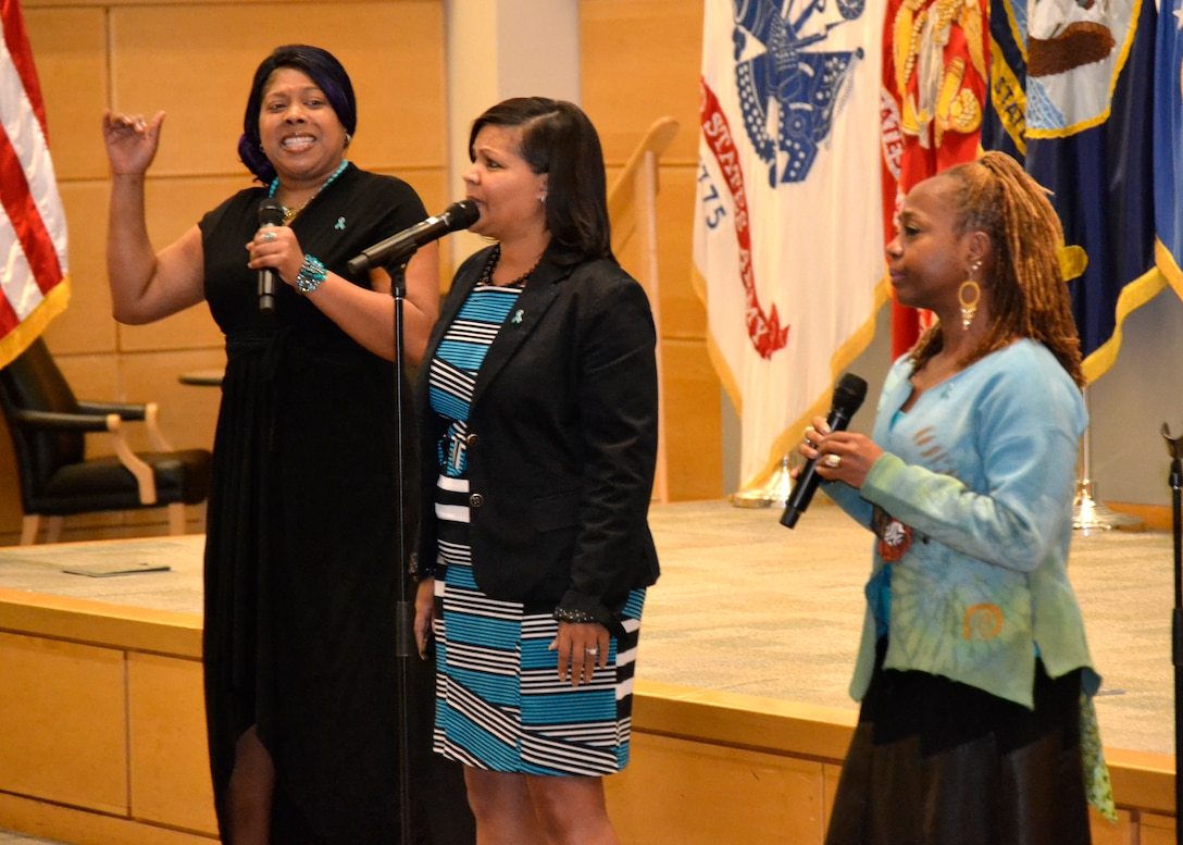 """LaTosha Wray, Ella Wynn and Dawn Morgan-Moore sing a rendition of Andra Day's """"Stand Up For Something"""" at DLA Troop Support's """"Speak Up, Stand Up"""" empowerment event April 4 in Philadelphia."""