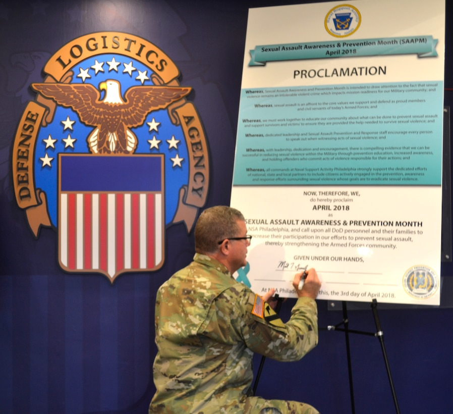 DLA Troop Support Commander Army Brig. Gen. Mark Simerly signs the 2018 Sexual Assault Awareness and Prevention Month proclamation April 2 in Philadelphia.