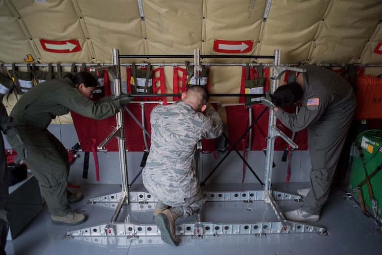 Aeromedical evacuation technicians assemble a stanchion litter system (SLS) before completing in-flight medical scenarios on a 507th Air Refueling Wing KC-135 Stratotanker at Tinker Air Force Base, Oklahoma, March 27, 2018. The flight was a part of MATOP (Multiple Aircraft Training Opportunity Program), a hands-on training program organized by the 137th Aeromedical Evacuation Squadron at Will Rogers Air National Guard Base in Oklahoma City. It was designed to provide aeromedical evacuation squadrons from across the U.S. opportunities to work with the C-130 Hercules, KC-135 Stratotanker and C-17 Globemaster III. The flight brought together aeromedical evacuation units from California, West Virginia, North Carolina, Minnesota, Wyoming, Delaware, Mississippi, New York and Oklahoma.(U.S. Air National Guard photo by Staff Sgt. Tyler Woodward)