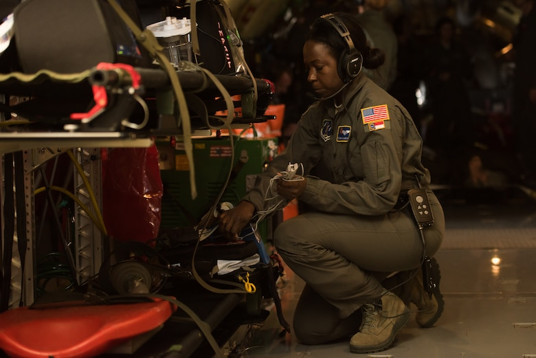 Tech. Sgt. Doretha McLaughlin, an aeromedical evacuation technician from the 156th Aeromedical Evacuation Squadron, North Carolina Air National Guard, secures medical equipment after completing an in-flight scenario on a KC-135 Stratotanker, from the 507th Air Refueling Wing, Tinker Air Force Base, Oklahoma, during MATOP (Multiple Aircraft Training Opportunity Program), March 27, 2018. MATOP was organized by the 137th Aeromedical Evacuation Squadron at Will Rogers Air National Guard Base in Oklahoma City and was designed to give aeromedical evacuation squadrons from across the U.S. a hands-on learning opportunity with the C-130 Hercules, KC-135 Stratotanker and C-17 Globemaster III. The flight brought together aeromedical evacuation units from California, West Virginia, North Carolina, Minnesota, Wyoming, Delaware, Mississippi, New York and Oklahoma. (U.S. Air National Guard photo by Staff Sgt. Tyler Woodward)