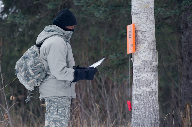 Spc. Nicholas Hayward, assigned to Hawk Company, 3rd Battalion, 509th Parachute Infantry Regiment, 4th Infantry Brigade Combat Team (Airborne), 25th Infantry Division, U.S. Army Alaska, plots his next point during a land navigation course on Joint Base Elmendorf-Richardson, Alaska, April 4, 2018.  Hayward and fellow Soldiers used their skills to plot courses using a lensatic compass, protractor, and a 1:25,000 scale map to navigate to, and locate points using provided grid coordinates within a predetermined time.