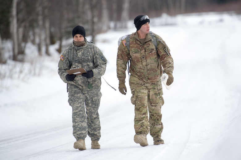 Army Sgt. Gary Santiago,and Spc. Alejandro Barboza, both assigned to Hawk Company,3rd Battalion, 509th Parachute Infantry Regiment, 4th Infantry Brigade Combat Team (Airborne), 25th Infantry Division, U.S. Army Alaska, conduct a land navigation course on Joint Base Elmendorf-Richardson, Alaska, April 4, 2018.  The Soldiers used their skills to plot courses using a lensatic compass, protractor, and a 1:25,000 scale map to navigate to, and locate points using provided grid coordinates within a predetermined time.