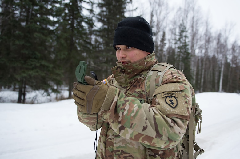 Army Sgt. Carlos Porras, a native of Burlington, NC, assigned to Hawk Company, 3rd Battalion, 509th Parachute Infantry Regiment, 4th Infantry Brigade Combat Team (Airborne), 25th Infantry Division, U.S. Army Alaska, shoots an azimuth with a compass during a land navigation course on Joint Base Elmendorf-Richardson, Alaska, April 4, 2018.  The Soldiers used their skills to plot courses using a lensatic compass, protractor, and a 1:25,000 scale map to navigate to, and locate points using provided grid coordinates within a predetermined time.