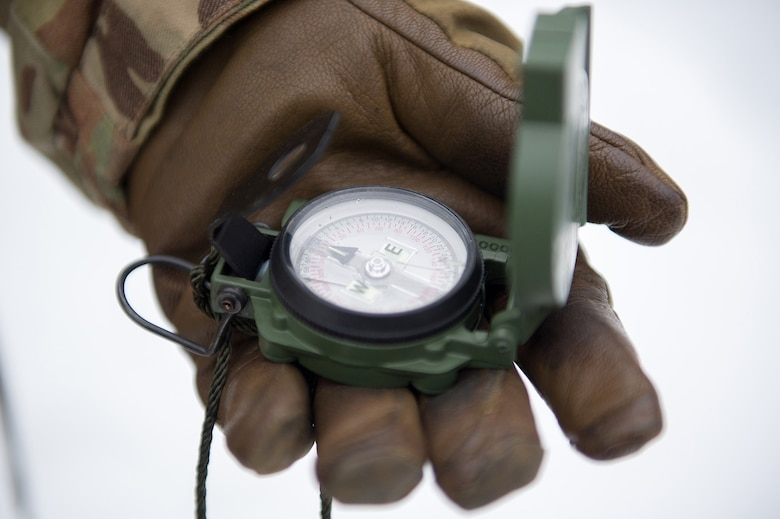 Army Sgt. Carlos Porras, a native of Burlington, NC, assigned to Hawk Company, 3rd Battalion, 509th Parachute Infantry Regiment, 4th Infantry Brigade Combat Team (Airborne), 25th Infantry Division, U.S. Army Alaska, holds a compass during a land navigation course on Joint Base Elmendorf-Richardson, Alaska, April 4, 2018.  The Soldiers used their skills to plot courses using a lensatic compass, protractor, and a 1:25,000 scale map to navigate to, and locate points using provided grid coordinates within a predetermined time.