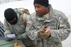Army Sgt. Gerrald Howard, a native of Atlanta, Ga., assigned to Hawk Company,3rd Battalion, 509th Parachute Infantry Regiment, 4th Infantry Brigade Combat Team (Airborne), 25th Infantry Division, U.S. Army Alaska, talks to Soldiers conducting a land navigation course on Joint Base Elmendorf-Richardson, Alaska, April 4, 2018.  The Soldiers used their skills to plot courses using a lensatic compass, protractor, and a 1:25,000 scale map to navigate to, and locate points using provided grid coordinates within a predetermined time.