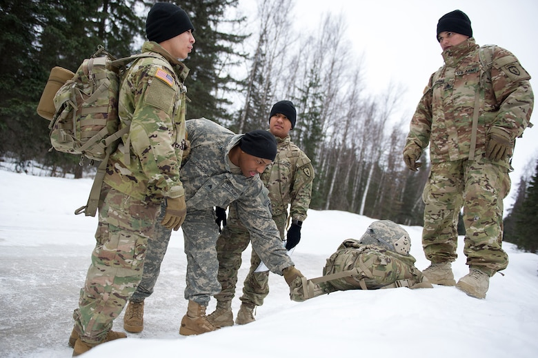 Paratroopers assigned to the 4th Infantry Brigade Combat Team (Airborne), 25th Infantry Division, U.S. Army Alaska, prepare to move out during a land navigation course on Joint Base Elmendorf-Richardson, Alaska, April 4, 2018.  The Soldiers used their skills to plot courses using a lensatic compass, protractor, and a 1:25,000 scale map to navigate to, and locate points using provided grid coordinates within a predetermined time.