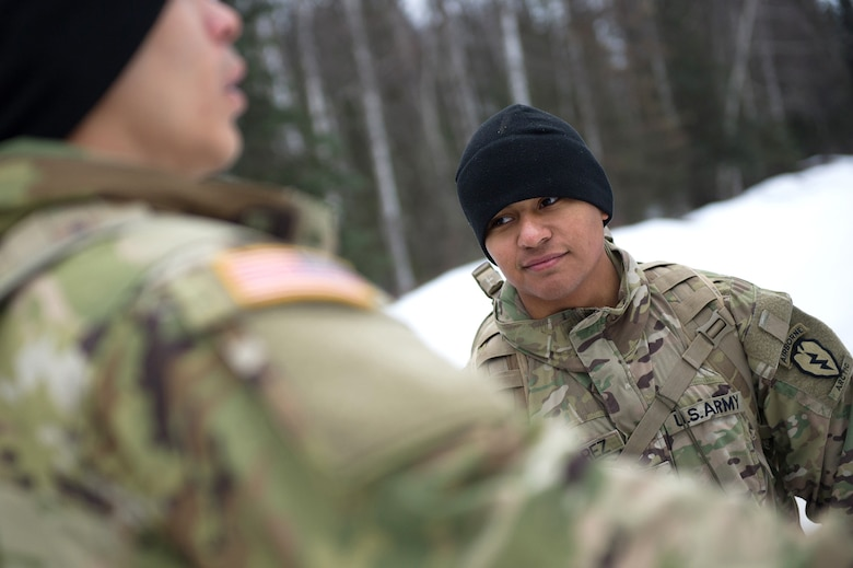 Army Sgt. Aldo Nevarez, a native of San Diego, Calif., assigned to Hawk Company, 4th Infantry Brigade Combat Team (Airborne), 25th Infantry Division, U.S. Army Alaska, listens to a fellow soldier while conducting a land navigation course on Joint Base Elmendorf-Richardson, Alaska, April 4, 2018.  The Soldiers used their skills to plot courses using a lensatic compass, protractor, and a 1:25,000 scale map to navigate to, and locate points using provided grid coordinates within a predetermined time.