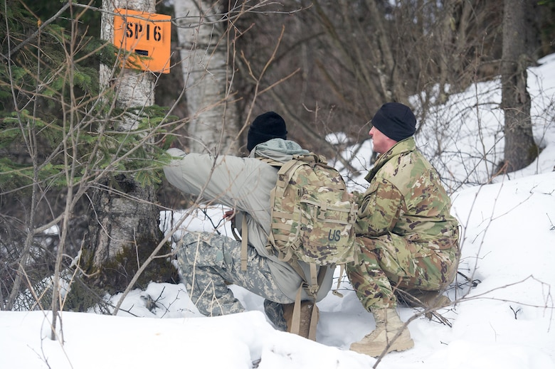 Paratroopers assigned to the 4th Infantry Brigade Combat Team (Airborne), 25th Infantry Division, U.S. Army Alaska, conduct a land navigation course on Joint Base Elmendorf-Richardson, Alaska, April 4, 2018.  The Soldiers used their skills to plot courses using a lensatic compass, protractor, and a 1:25,000 scale map to navigate to, and locate points using provided grid coordinates within a predetermined time.
