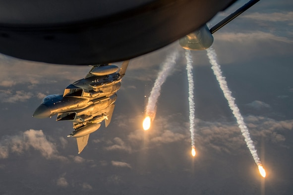 A U.S. Air Force F-15 Eagle deploys flares while departing from a KC-135 Stratotanker assigned to the 340th Expeditionary Air Refueling Squadron during a refueling mission above Iraq March 16, 2018. The 340th EARS is assigned to the 379th Expeditionary Operations Group and supports various operations in countries such as Iraq, Syria and Afghanistan. (U.S. Air Force Photo by Tech. Sgt. Paul Labbe)
