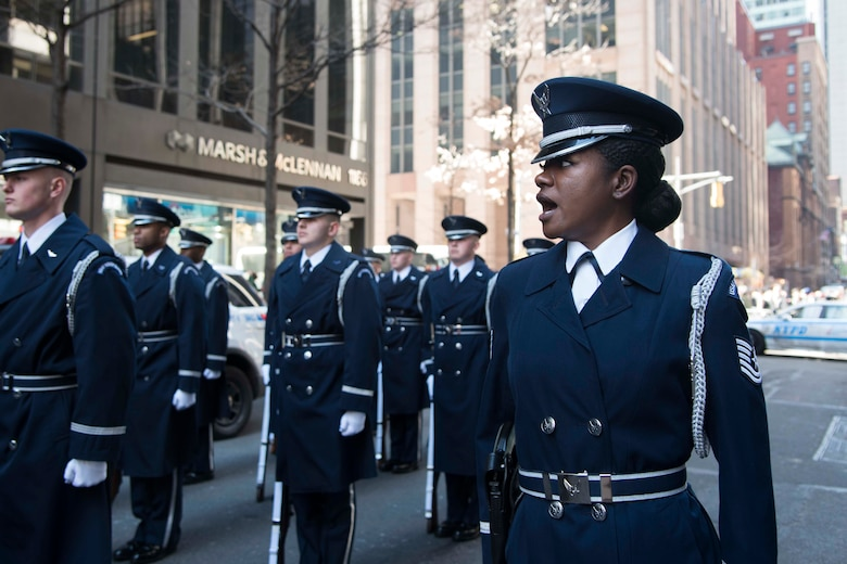 Tech. Sgt. Chloe Rainey, U.S. Air Force Honor Guard ceremonial guardsman, commands her flight during the New York City St. Patrick�s Day Parade, March 17, 2018. The Honor Guard participated in St. Patrick�s Day parades in New York City and Boston, as part of the team�s U.S. northeastern outreach tour to recruit, retain and inspire Airmen. (U.S. Air Force photo by Airman 1st Class Valentina Viglianco)