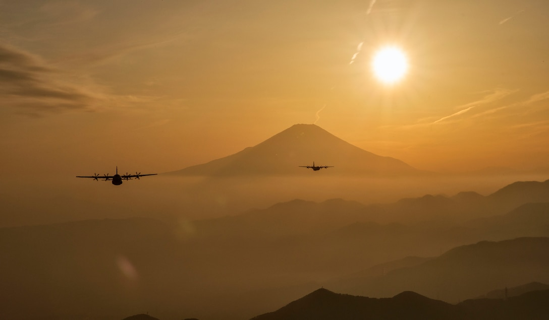 Two C-130J Super Hercules fly over Yamanashi Prefecture, Japan, after conducting airdrop training missions, March 26, 2018. The C-130J assigned to the 36th Airlift Squadron regularly conducts training missions to remain proficient in necessary skills to support any contingency. (U.S. Air Force photo by Yasuo Osakabe)