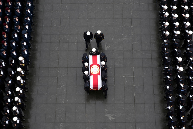 Maj. Christopher Zanetis, 101st Rescue Squadron pilot, 106th Rescue Wing, New York Air National Guard, is honored during a procession led by the Fire Department of New York through lower Manhattan March 29, 2018. Zanetis lost his life close to the Iraq/Syrian border when his aircraft, an HH-60G Pave Hawk helicopter crashed near the city of Al-Qa'im. Zanetis was a member of the New York City Fire Department. (U.S. Air National Guard photo by Christopher Muncy)