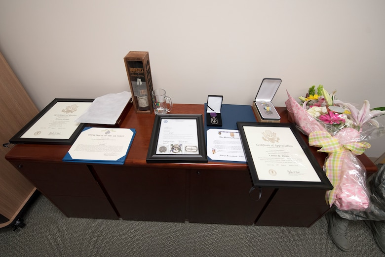 Certificates and commendation medals honoring Arlonzo Nelson, 23d Maintenance Group computer assistant, rest on a table during a retirement ceremony, March 29, 2018, at Moody Air Force Base, Ga. Nelson is retiring after 30 years of civilian service here. (U.S. Air Force photo by Airman Eugene Oliver)