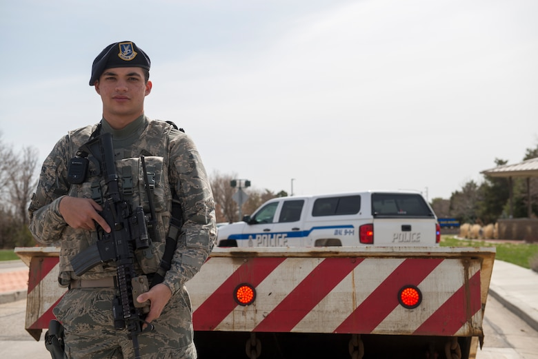 Airman 1st Class Marcus Young, 366th Security Forces Squadron response force member, stands in front of a barrier, April 3, 2018, at Mountain Home Air Force Base, Idaho. The 366th Fighter Wing is constantly evolving installation security measures to stay on guard and prevent incidents from occurring. (U.S. Air Force photo by Airman 1st Class JaNae Capuno)