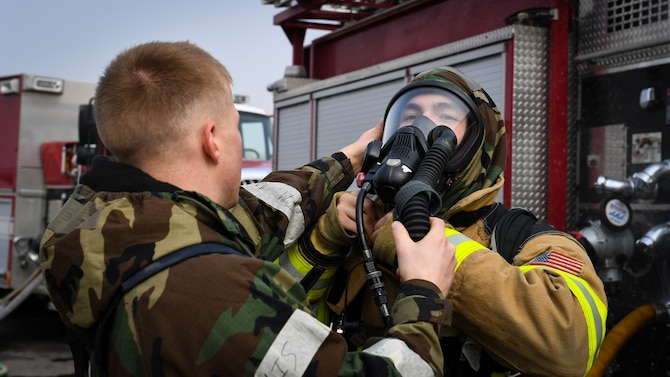 U.S. and Republic of Korea Air Force firefighters work together to put out a fire during a training exercise on Osan Air Base, Republic of Korea, March 26, 2018.