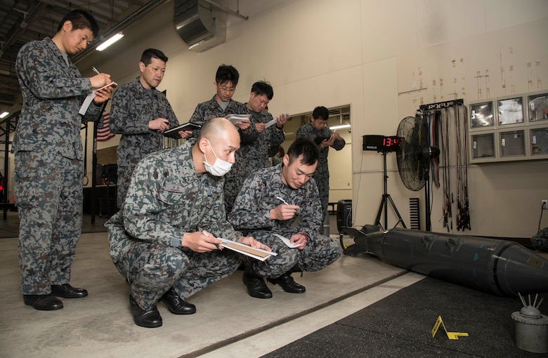 Japan Air Self-Defense Force 3rd Air Wing weapons maintenance technicians and Tohoku Sub Base, Tohoku, Japan, explosive ordnance disposal instructors classify an inert unexploded ordnance as a part of their EOD training school requirements at Misawa Air Base, Japan, March 29, 2018. In order to better protect Japan and its allies, the 35th Civil Engineer Squadron EOD flight trained instructors from JASDF Tohoku EOD School the basics of identifying and responding to UXOs. Despite the language barrier, all members took away knowledge to bring back to their units. (U.S. Air Force photo by Senior Airman Sadie Colbert)