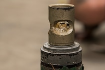 A fuse remains exposed on an inert sub-munition bomblet during a bilateral explosive ordnance disposal training class at Misawa Air Base, Japan, March 29, 2018. A group of 11 Japan Air Self-Defense Force 3rd Air Wing weapons maintenance technicians and Tohoku Sub Base, Tohoku, Japan explosive ordnance disposal instructors, participated in the class. As a part of their training, personnel had to identify 20 various types of unexploded ordnances while knowing how different components make up the ordnance. (U.S. Air Force photo by Senior Airman Sadie Colbert)