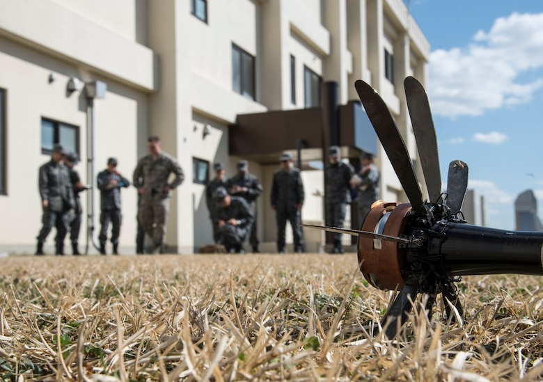 An inert foreign rocket lays exposed during unexploded ordnance disposal reconnaissance training at Misawa Air Base, Japan, March 30, 2018. During the training, the 35th Civil Engineer Squadron explosive ordnance disposal teams worked with Japan Air Self-Defense Force Airmen from the 3rd Air Wing and the Tohoku Subordinate Base, Tohoku, Japan, EOD unit to practice executing a bilateral mission together. They also took the time to train newer JASDF personnel on foundational methods of UXO reconnaissance. (U.S. Air Force photo by Senior Airman Sadie Colbert)
