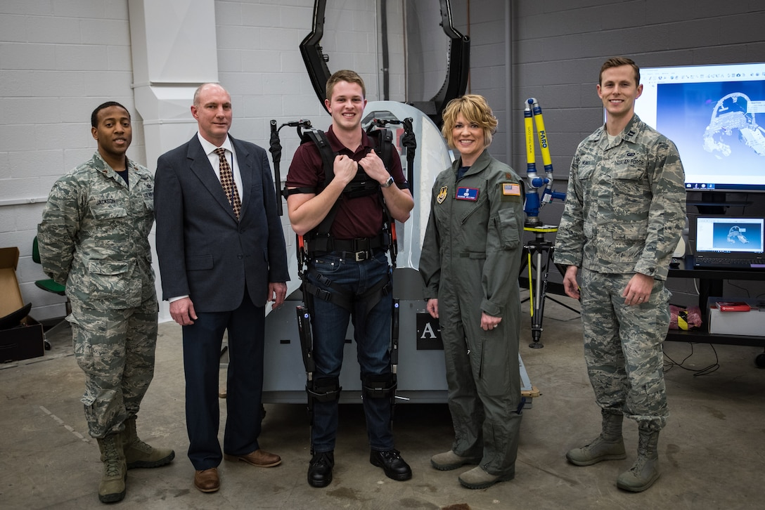 Maj. Shawnee Williams (second from right) stands with her team (from left) - Maj. Bryan Jackson, Dr. Daniel Mountjoy, Mr. Corey Shanahan, and Capt. Dan Neal - in the newly renovated anthropometry lab at the 711th Human Performance Wing's Human Systems Integration Directorate. (U.S. Air Force photo by Rick Eldridge)