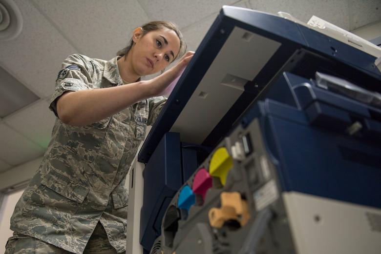 Senior Airman Amy Kristoffersen, 374th Communications Squadron Operations Flight client systems technician journeyman, verifies system setting prior to completing a printer swap at Yokota Air Base, Japan, April 4, 2018.