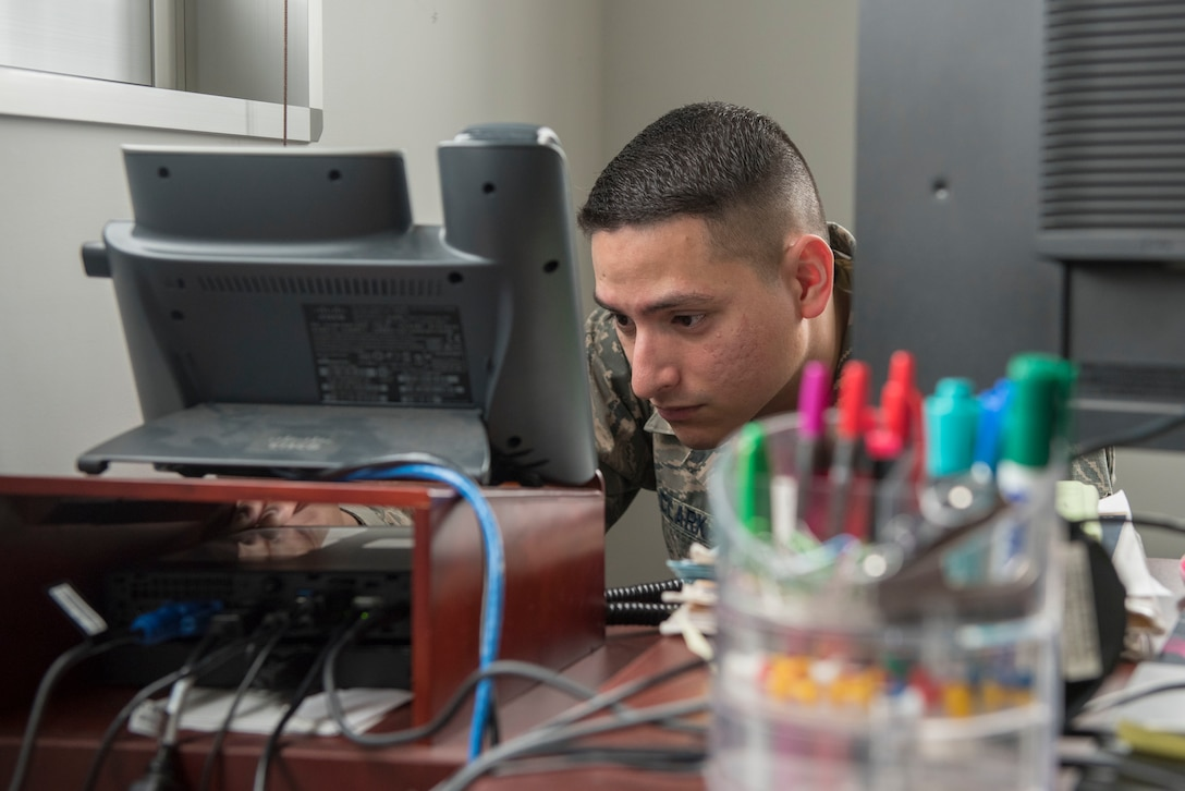 Senior Airman Shawn Clark, 374th Communications Squadron Operations Flight client systems technician journeyman, attempts to turn on a computer while troubleshooting at Yokota Air Base, Japan, April 5, 2018.