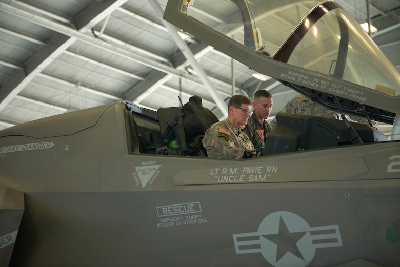 Lt. Col. Chad Vaughn, an F-35B Lightning II pilot stationed at Marine Aircraft Group 11, out of Yuma, Ariz. briefs GEN. Joseph L. Votel, commander of United States Central Command.  The purpose of the visit was to inform CENTCOM senior leaders of the capabilities of the aircraft and how it meets the demands of the complex CENTCOM environment.