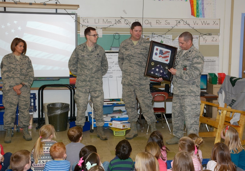 Lt. Col. Eugene R. Mozzoni, 157th Civil Engineer Squadron commander, thanks students at the Garrison Elementary School in Dover, N.H. March 30, 2018. Mozoni presented a flag and certificate to the students during a ceremony thanking the students for sending letters to the engineers while they were deployed to the Middle East. The flag was flown over the country of Kuwait during the last holiday season. (N.H. Air National Guard photo by Master Sgt. Thomas Johnson)