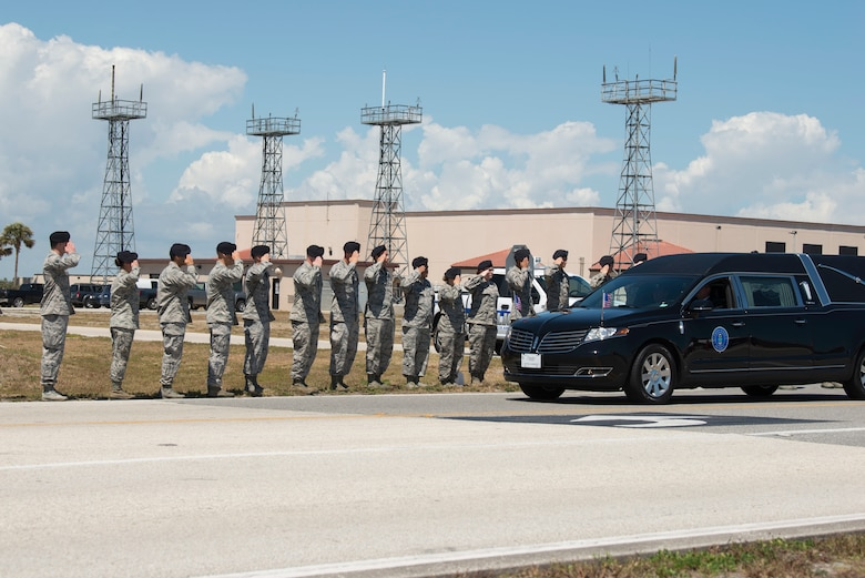 The Patrick Air Force Base community came out in full force to honor Master Sgt. William Posch upon his dignified arrival and transfer at Patrick Air Force Base, Florida April 4. He was killed in a helicopter crash last month in Iraq. Both civilian and military personnel stood shoulder-to-shoulder lining the streets during Posch's dignified transfer to honor an American hero and his family for their ultimate sacrifice. As his motorcade passed by, those in uniform rendered a salute while civilians placed their hand over their heart. (U.S. Air Force photo)