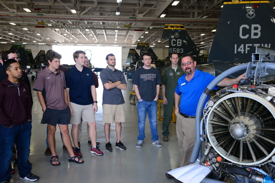 Charles Hill, L3 Communications T-38C Talon foreman, talks with the Mississippi State University Aircraft Propulsion Class about a T-38 engine April 4, 2018, on Columbus Air Force Base, Mississippi. The students visited the 14th Operations Group aircraft simulators, BLAZE Hangar and the L3 Propulsion Lab. (U.S. Air Force photo by Airman 1st Class Beaux Hebert)