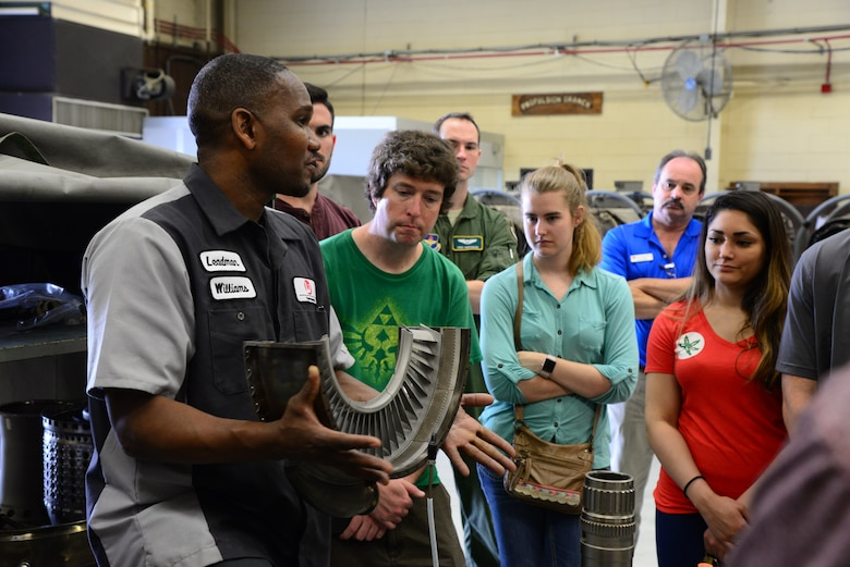 Rodney Williams, L3 Communications Propulsion Lab leadman, talks with the Mississippi State University Aircraft Propulsion Class about parts of a T-38C Talon engine April 4, 2018, on Columbus Air Force Base, Mississippi. The majority of aircraft mechanics on Columbus AFB are contracted through L3 Communications. (U.S. Air Force photo by Airman 1st Class Beaux Hebert)